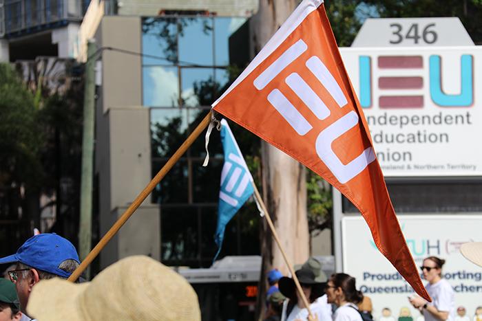 Flag and IEU sign
